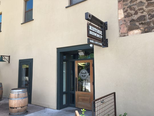 A modest front door is the gateway to flavorful beers available in the Historic Brewing taproom.