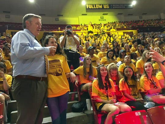 ASU President Michael Crow poses for picture with students