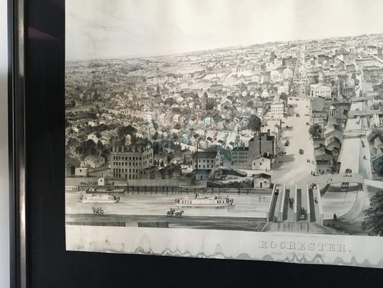 A framed historical print of Rochester.