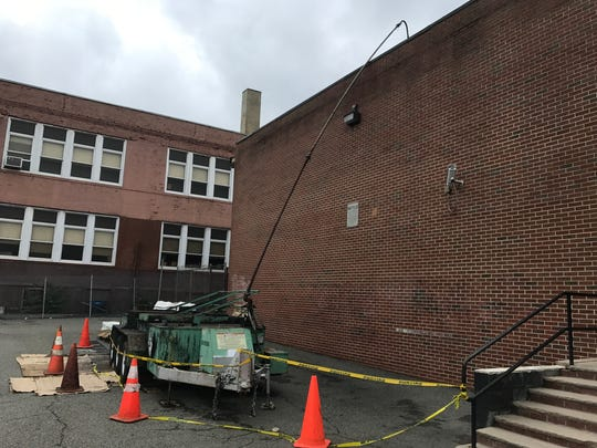Equipment for roof work is ready at Belleville's School No. 4 on Friday, Aug. 18, 2017.