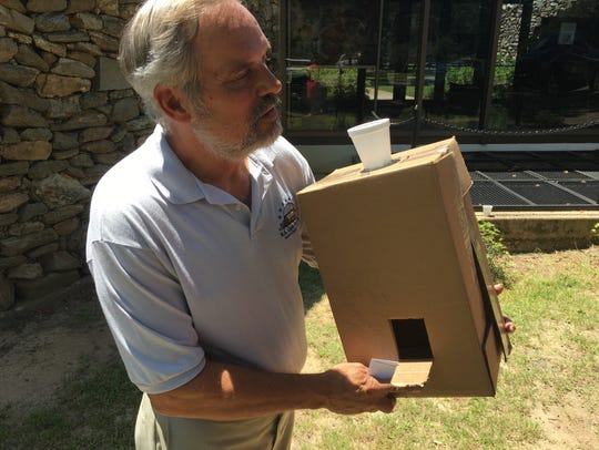 W.A. Gayle Planetarium Director Rick Evans with a homemade