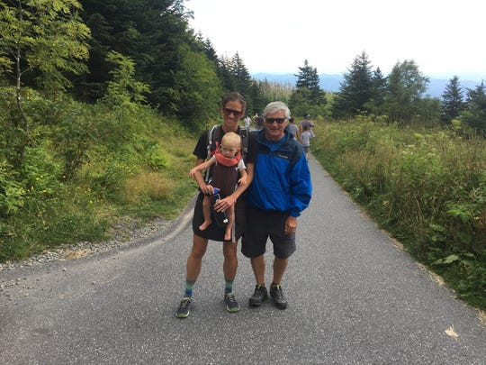 Jennifer Pharr Davis, holding her son, Gus, get a send off from Friends of the Mountains-to-Sea president Steve Metcalf at the start of her 1,175-mile journey.