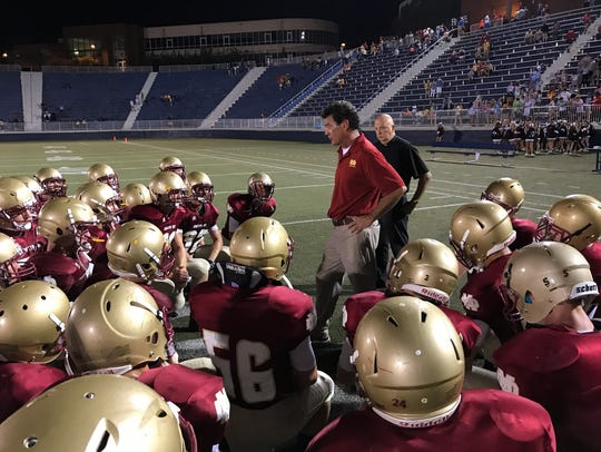 Coach Mike Goebel talks to his Mater Dei Wildcats after