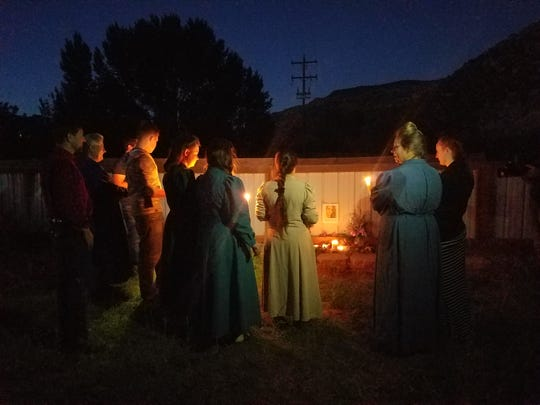 Hildale and Colorado City residents gather Saturday night around a memorial to a woman killed in a Charlottesville, Va., demonstration and counter-protest over Civil War history and racial harmony last weekend. The memorial was part of a Hildale event in solidarity with groups nationwide concerned about racist violence.