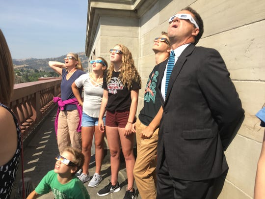 Governor Steve Bullock watches the solar eclipse with