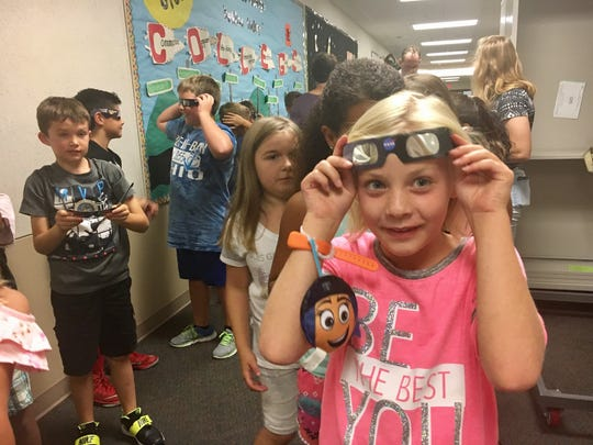 Third-graders at Maple Glen Elementary in Westfield prepare to see the partial eclipse Monday, Aug. 21, 2017.