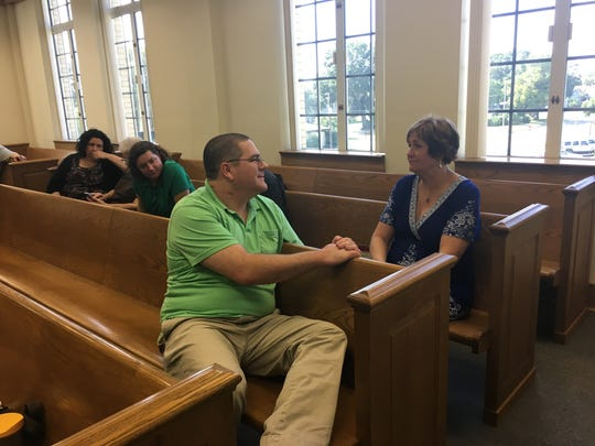 Jason Mahar, brother of crash victim Jennifer Jenkins, speaks to his mother, Sharon Mahar, during a break in jury selection Monday, Aug. 21, 2017, in Hardee County. Family members of the crash victims have attended every hearing for defendant Michael Phillips.