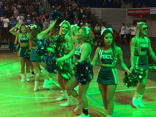 Florida Gulf Coast University cheerleaders entertain the crowd of about 3,800 during Monday night's ninth annual Eagle Revolution.