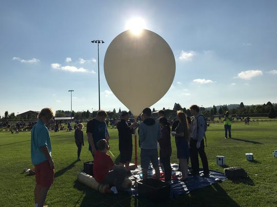 Students at Silverton High School prepare to launch a high-altitude balloon as part of a solar eclipse experiment.