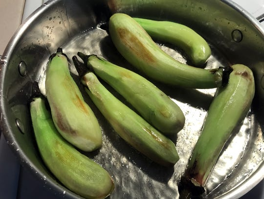 Fry the eggplant to give them extra flavor and to keep