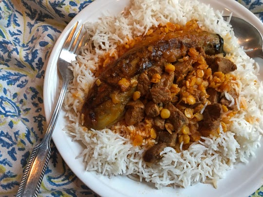 Serve Khoresht-e Ghaimeh Badamjoon on a bed of basmati rice