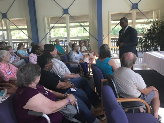 Democratic candidate for lieutenant governor, Justin Fairfax, addresses the crowd during the meet and greet at Accomack County Airport in Melfa,