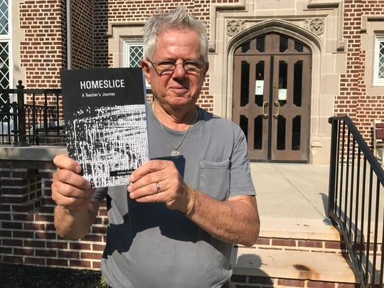 """George Pereny with his poetry book, """"Homeslice:A Teacher's Journey,"""" in front of the Pompton Lakes library."""