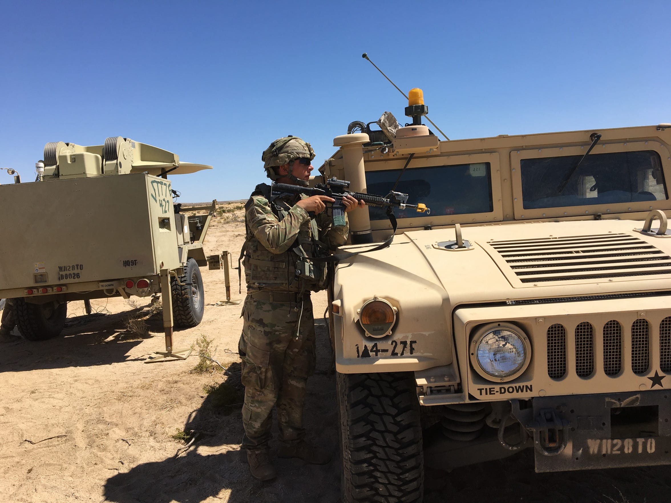 A soldier responds to an enemy attack by the opposing