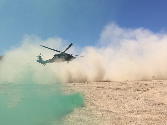 A Black Hawk helicopter lands at the National Training Center and its crew practices doing medical evacuations.
