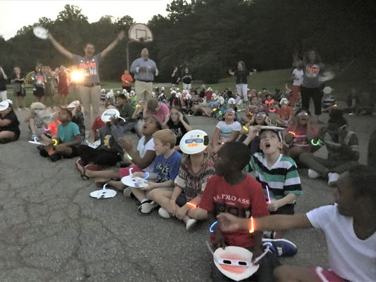 Central Elementary students and staff at 2:38 p.m., the moment of totality for Eclipse 2017.