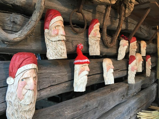 Santa Claus carvings made by Don Leiser of Oak Harbor