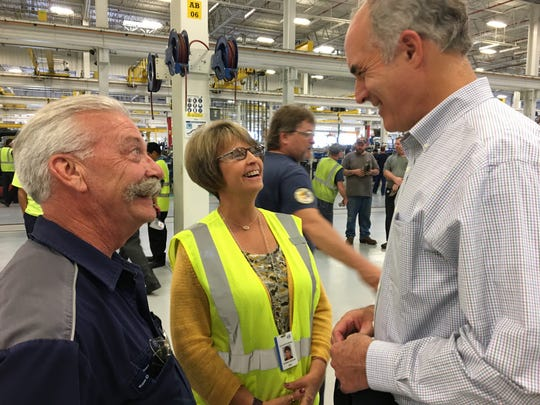 Dana and Susan Hoover of Newburg talk to Sen. Robert Casey Jr., D-Pa., about the Volvo Construction Equipment factory on Aug. 23, 2017.