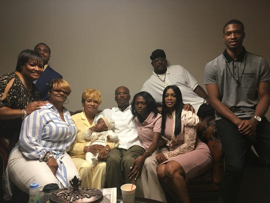 Desmond Ricks (center) spent 25-years in prison for