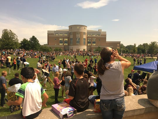 About 750 local students in grades K-8 visited the University of Southern Indiana's campus for Monday's near-total solar eclipse. The students learned about the eclipse and safety procedures from USI officials, and some kids made cereal box viewers.