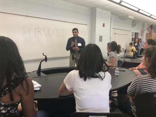 Teacher Ali Bhatti speaks to students, teachers, administrators and biotechnology professionals for the  public introduction of the academy, which was founded at Mountain Lakes High School in partnership with the Morris County Vocational School District. August 24, 2017