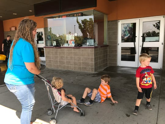 Bobbie West, 24, with her daughter and two nephews stopped by Cinemark 14 to get her ticket refund.