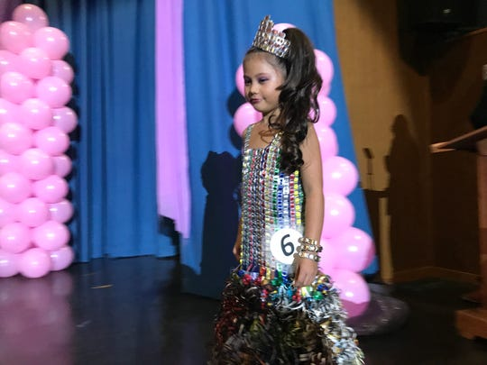 Janae Blas shows her spunky attitude while walking in her recycled materials costume at the first Little Miss Guam pageant on Aug. 27.