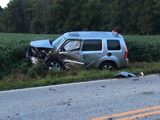 A silver Honda Pilot was damaged in a crash on Pleasant