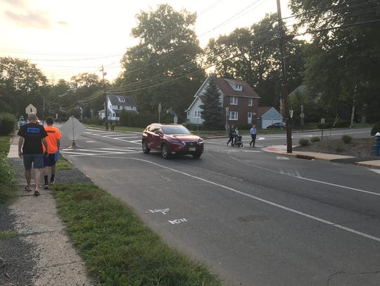 A car travels along Millburn Avenue near its intersection