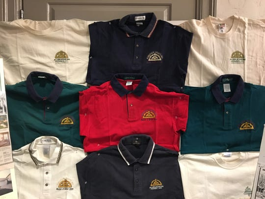 The different company shirts collected by Gary Aubuchon's