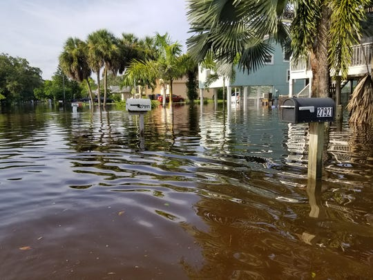 A neighborhood near Bonita Beach Road and Imperial Parkway sits under feet of water spilling from the Imperial River on Monday.