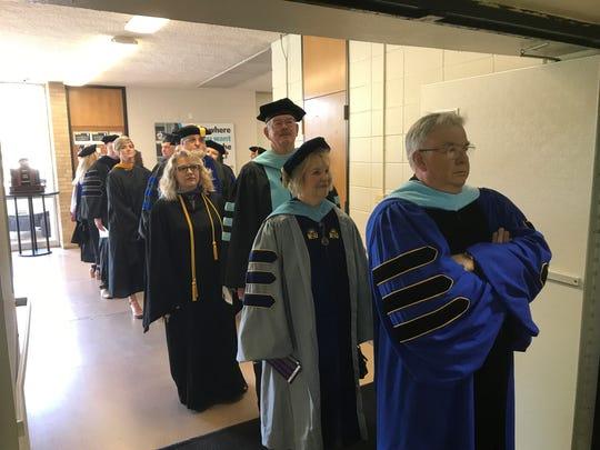 Abilene Christian University faculty line up to enter opening chapel Monday, Aug. 28, 2017.