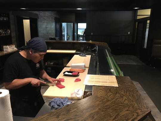 A Sushi Lover sushi chef prepares fish for the lunch crowd.
