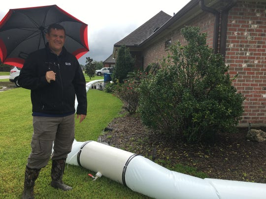 Stafford Barnett built a water barrier around his Lafayette home to prepare for potential flooding from Tropical Storm Harvey.