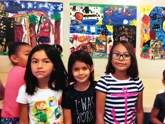 Three of the elementary school pupils who created art during Charlie Ciali's artist-in-residence program. The works will be shown and auction at a Cathedral City gallery exhibition.