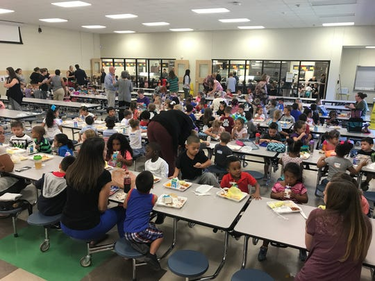 It's a sea of little humans at lunchtime within the cafeteria of Long Early Learning Center, as hundreds of 3- and 4-year-old children eat lunch at Long's first day of school Tuesday, Aug. 29, 2017.