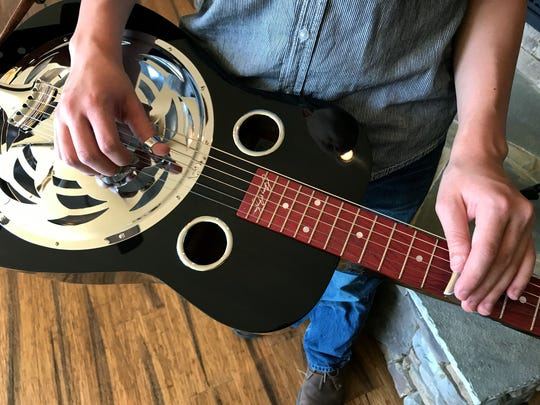 Duncan Stitt, a 13-year-old dobro-player who recently became the youngest person to win an award at Colorado's RockyGrass festival, in his home in East Knox County Tuesday, Aug. 29, 2017.