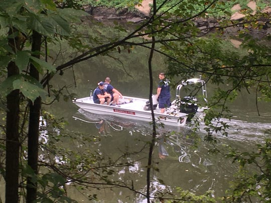 Nashville firefighters on the Stones River investigating