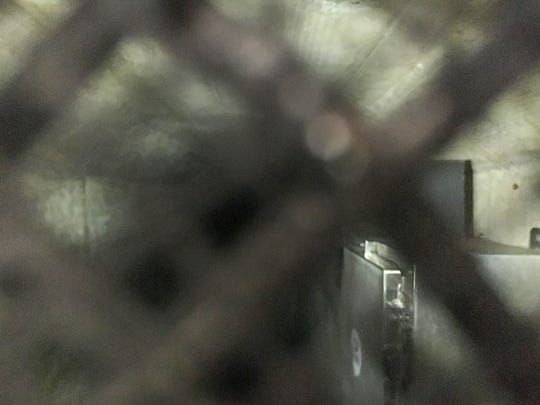 The interior of one of Nestle's water tunnels, as seen through a small vent in the locked metal door. Records show this tunnel was built in the 1940s and extends 89 feet into the mountainside.