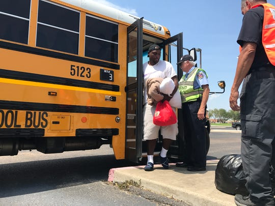 Adrian Wilson steps off a bus Thursday Aug. 31, 2017. Wilson was one of more than 800 evacuees who returned to Corpus Christi from San Antonio.