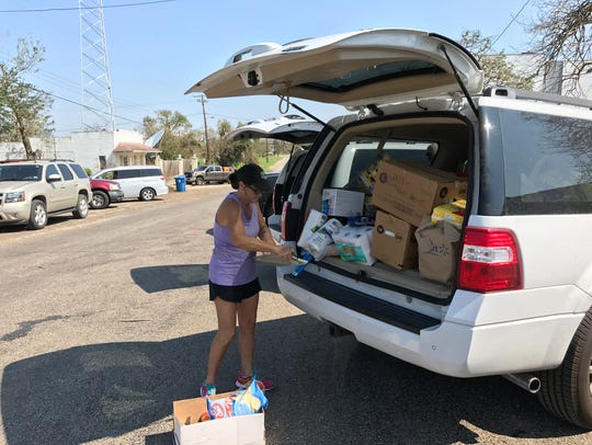 A volunteer at Our Lady of Refuge Church in Refugio