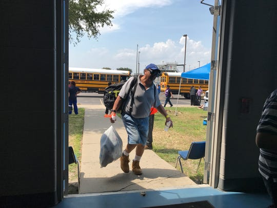 Buses of refugees returned to Corpus Christi Thursday in the aftermath of  Hurricane Harvey. More than 800 people had evacuated to San Antonio as the Category 4 storm bore down on the Texas coast.