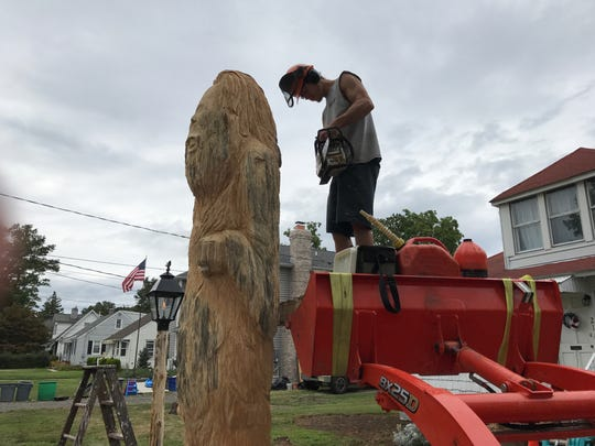 Brett Strother, a freelance artist from West Milford, has been working for the past week to carve a nine foot tall Sasquatch in the front yard of his brother's property on Schuyler Avenue in Pompton Lakes. The log came from a tree that his brother, Brandon, dad Larry, and he cut down last fall.