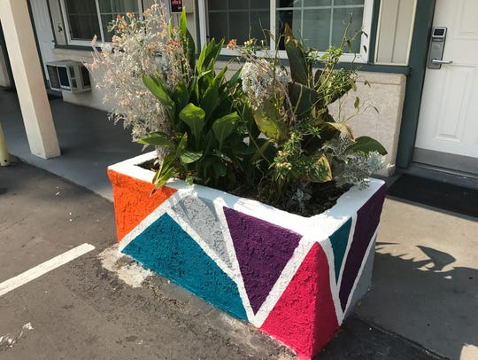 A flower box is painted to match the new motif at Travel
