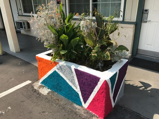 A flower box is painted to match the new motif at Travel Inn in downtown Redding