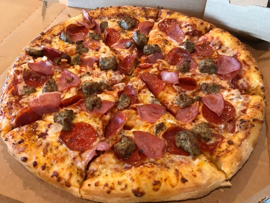 A fresh out of the oven Domino's Pizza