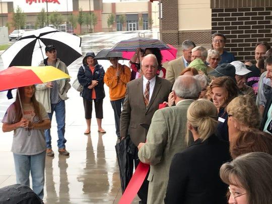 Oak Ridge and Belk officials cut a ribbon in the rain