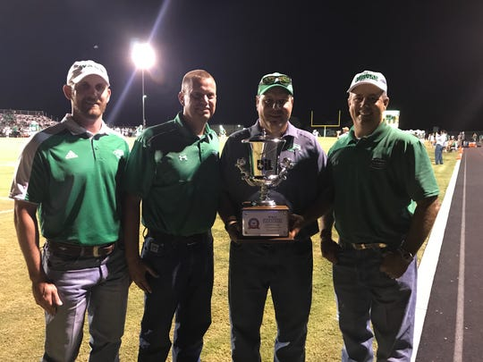 (From left to right) Wall middle school principal Matt Rivers, Wall high school principal Ryan Snowden, athletic director Jeremy Williams and superintendent Russell Dacy show the Lone Star Cup the school was awarded Friday, Sept. 1, 2017, at Hawk Stadium in Wall.