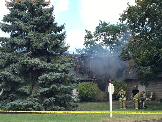 Firefighters on the scene of a fire at the Willow Creek