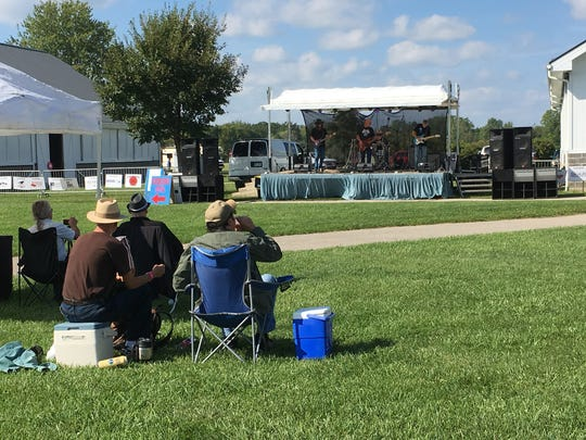 Visitors listen to BlueBlaze at the eighth annual BlueChiliGrass Festival. This is the first year the festival has been held on the north side of the Goodells County Park. The event was hosted on the south side in previous years.